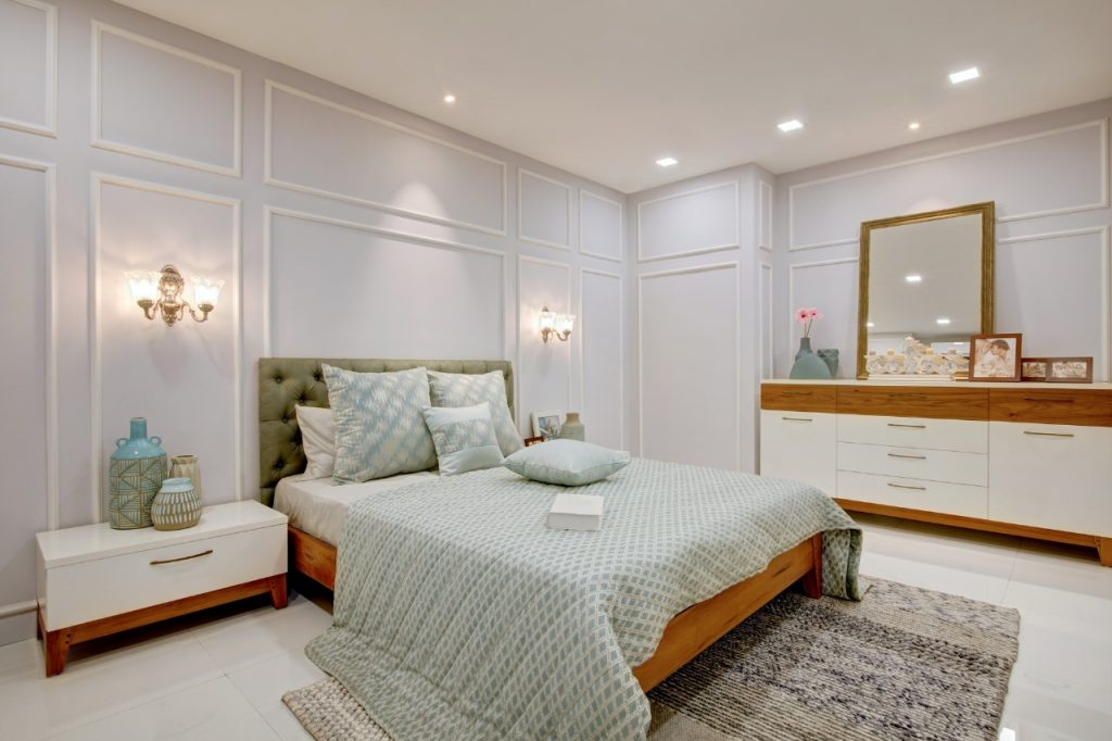 Bedroom interiors Kerala with king size bed and bedside tables